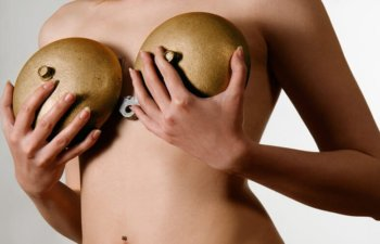 Woman Covering Her Breasts with Bells